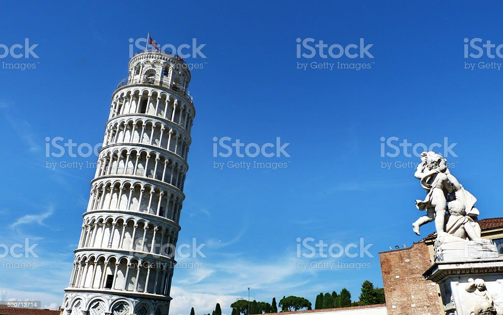 Leaning Tower with the fountain of cherubs in Pisa stock photo