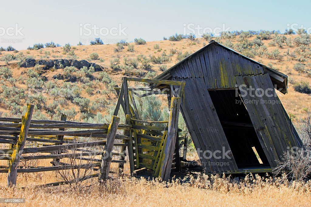 Leaning Weathered Outbuilding in the Wild West stock photo