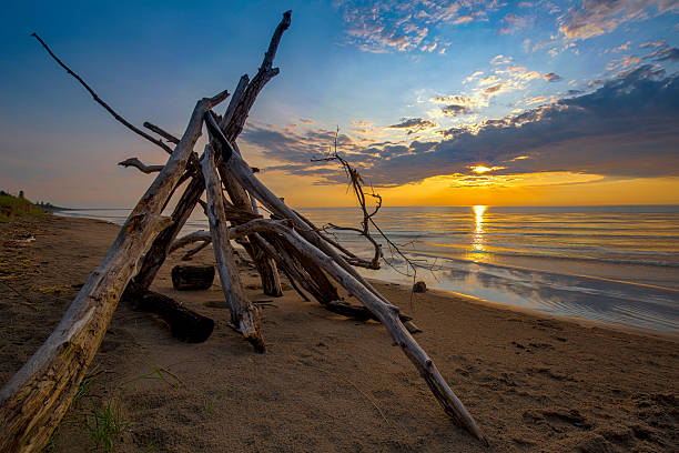 lean-to on a lake huron beach as the sun sets - provincial park stock photos and pictures