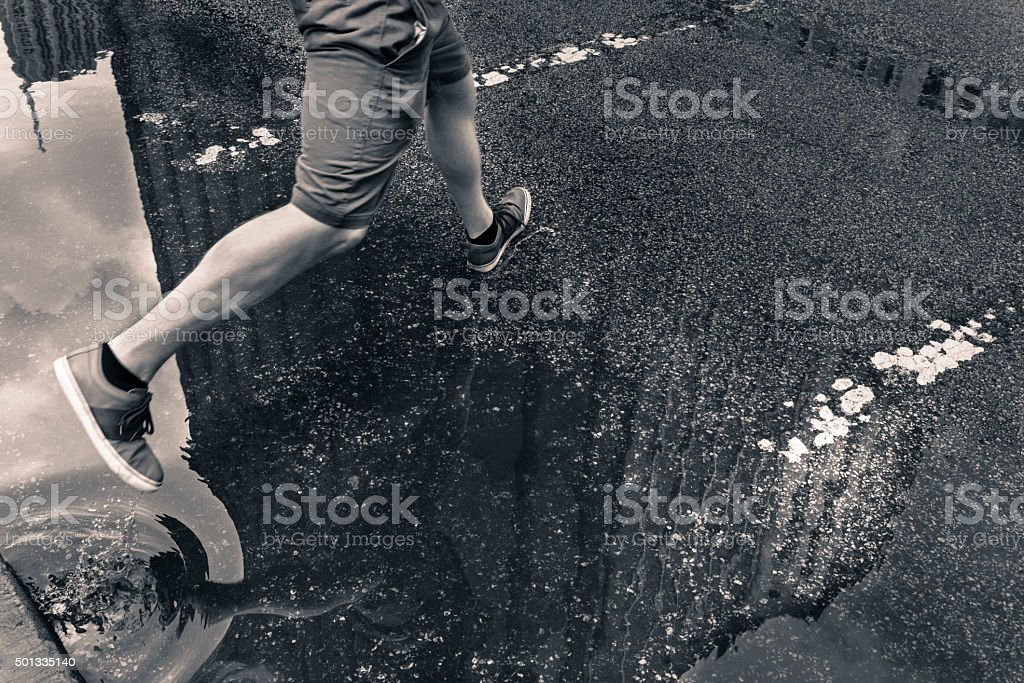 Leap over the puddle royalty-free stock photo