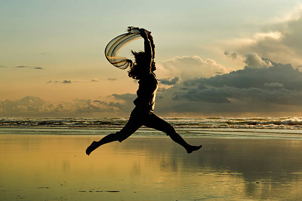 Leaping at sunset. stock photo