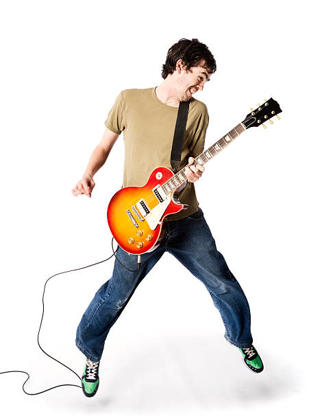 Leaping rocker White men can jump, apparently. But not so high. guitarist stock pictures, royalty-free photos & images
