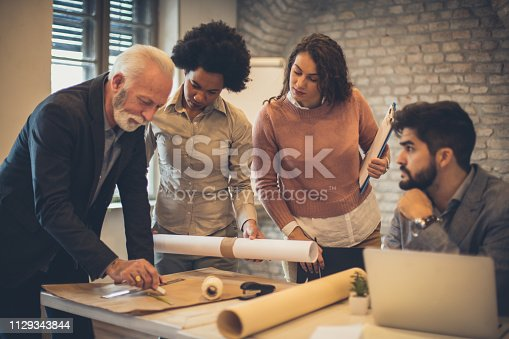 Learn from the elderly. Business people working in office on the new plan.