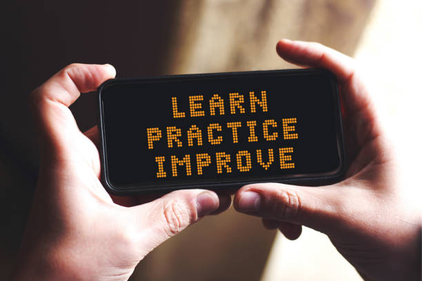 learn practice improve concept on screen smart phone - practicing stock pictures, royalty-free photos & images