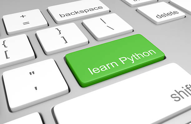 Learn Python key on keyboard for learning to build websites stock photo