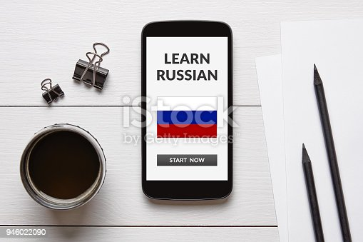 1134879628 istock photo Learn Russian concept on smart phone screen on white wooden table 946022090
