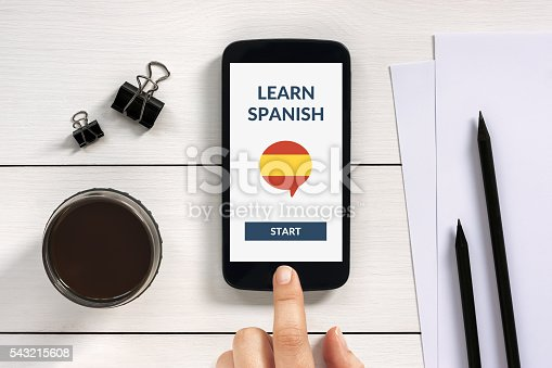 1134879628 istock photo Learn spanish concept on smart phone screen with office objects 543215608