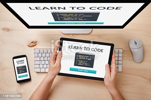 995213208 istock photo Learn to code concept on responsive devices 1181032200