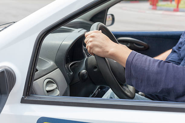Learner driver driving car with instructor Driving school. Learning to drive a car. driving instructor stock pictures, royalty-free photos & images