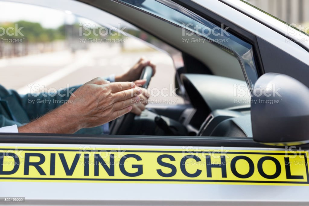 Learner driver student driving car with instructor stock photo