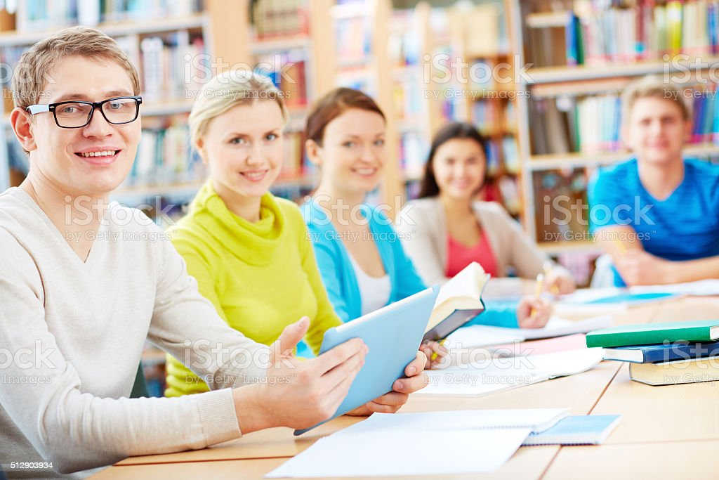 Learners in library stock photo