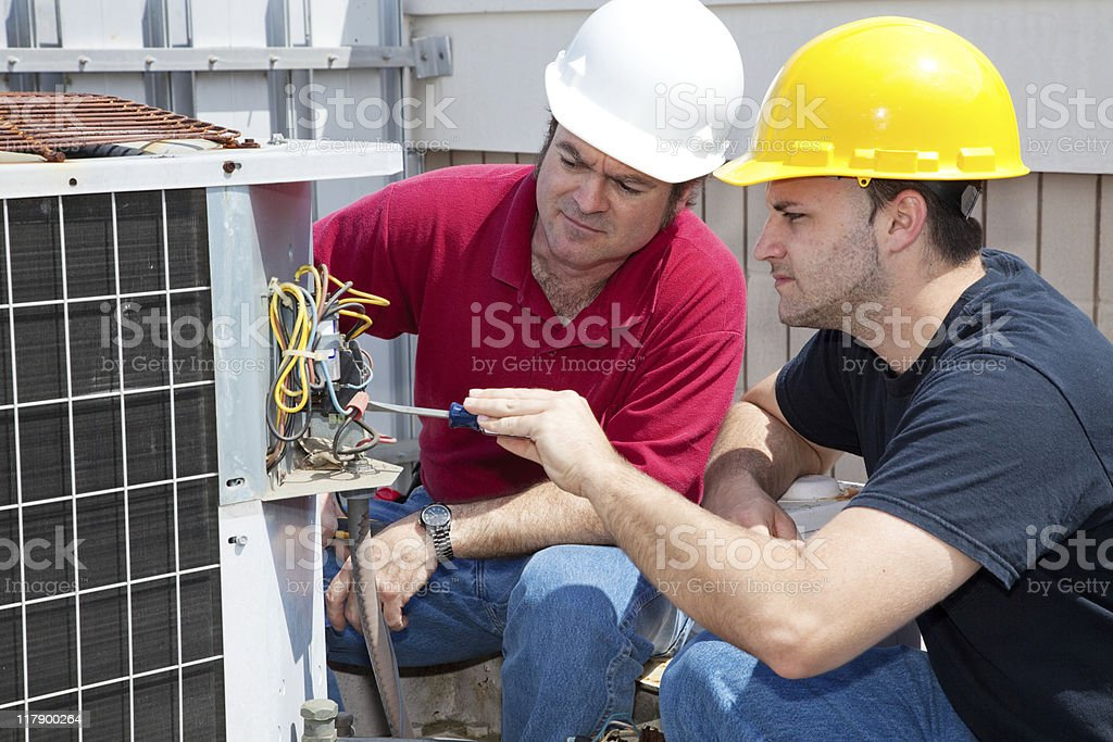 Learning Air Conditioning Repair royalty-free stock photo