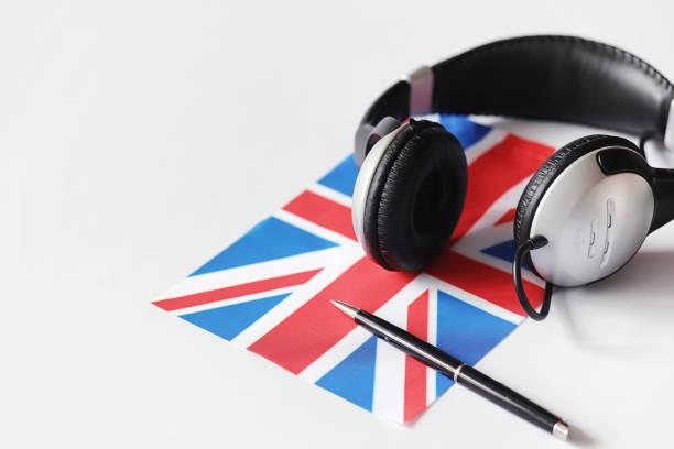 erlernen von fremdsprachen. notizblock für einträge und eine fahne. lang - england stock-fotos und bilder