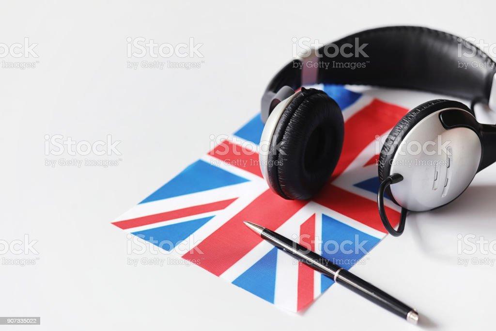 Apprendre des langues étrangères. Bloc-notes pour les entrées et un drapeau. Lang - Photo