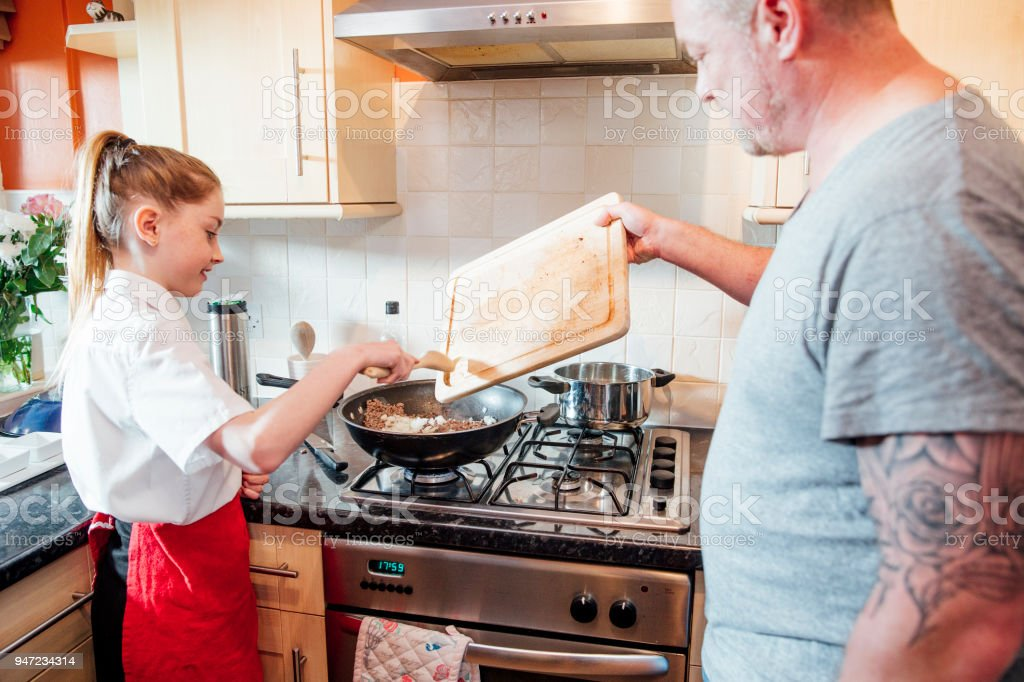Learning how to Cook with Dad stock photo