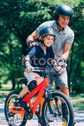 853720192 istock photo Learning how to ride a bicycle 615421542
