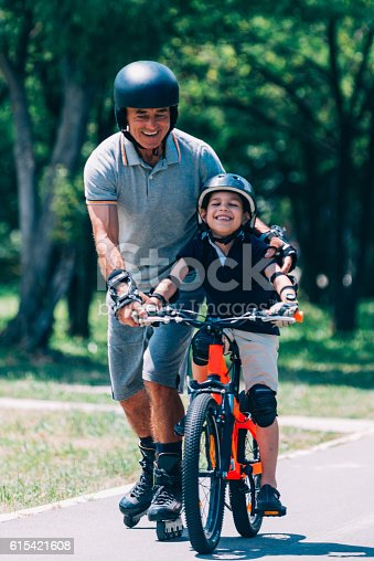 853720192 istock photo Learning how to ride a bicycle 615421608