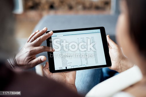 Cropped shot of an unrecognizable senior couple sitting together and looking at their financial budgets on a tablet