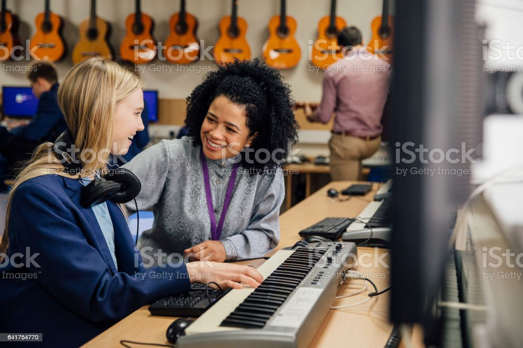 Learning Keyboard In Music Lesson stock photo