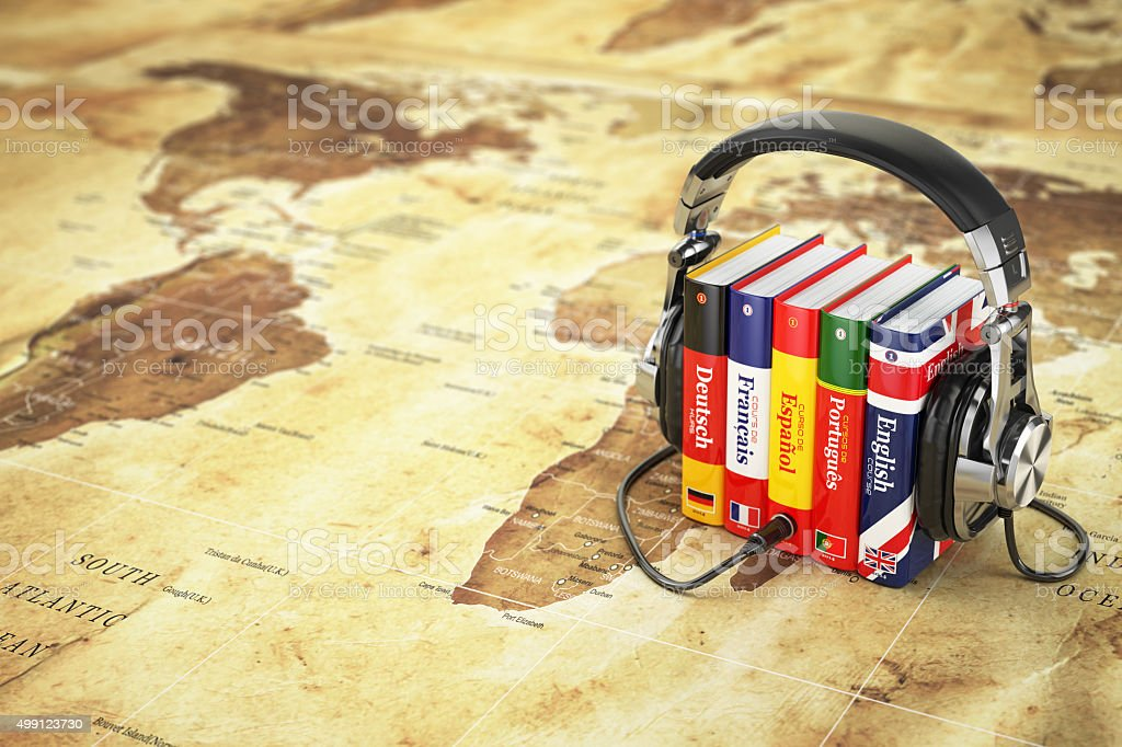 Learning languages online. Audiobooks concept. Books and headpho stock photo