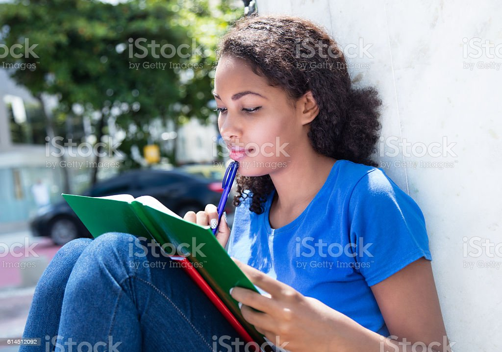 Learning latin female student with curly hair