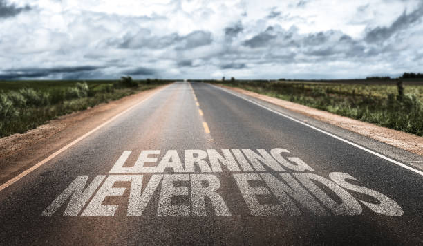 Learning Never Ends Learning Never Ends written on rural road eternity stock pictures, royalty-free photos & images