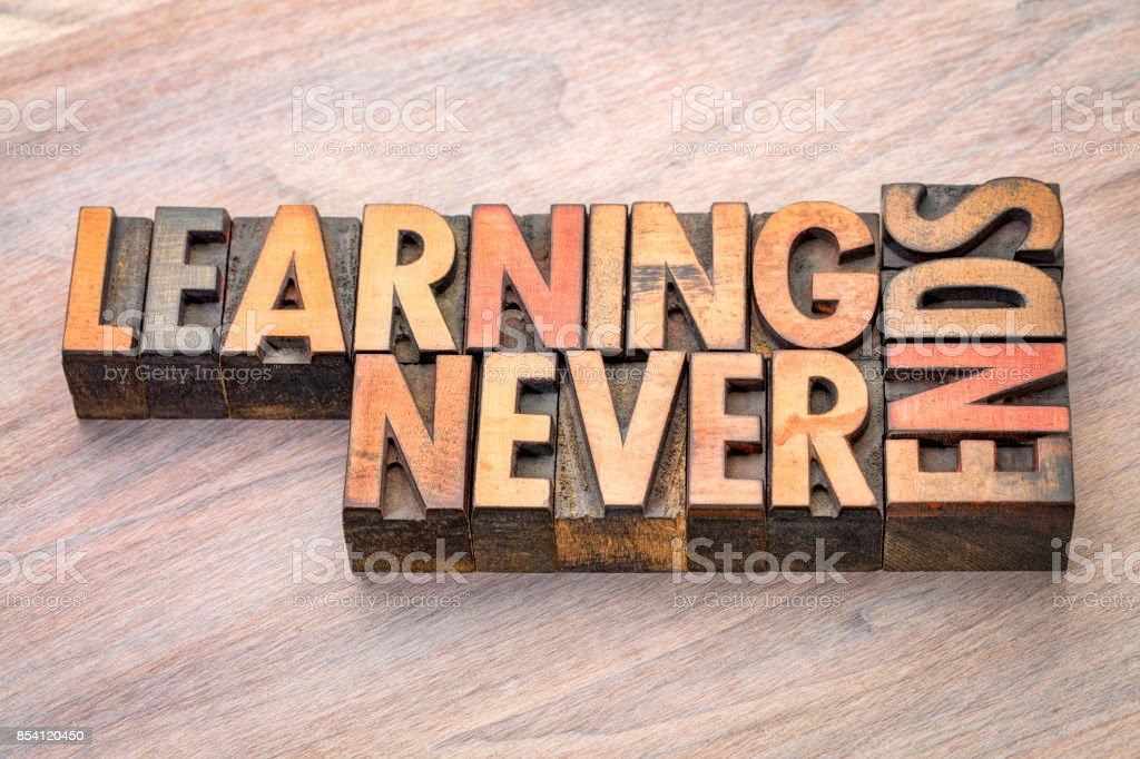 Learning never ends word abstract in wood type stock photo
