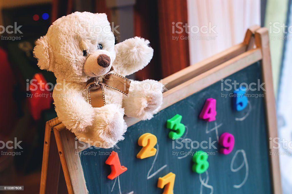 Learning numbers with a teddy bear stock photo