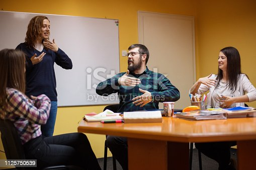 Group of people learning sign language