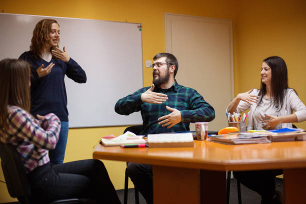 Learning sign language Group of people learning sign language signing stock pictures, royalty-free photos & images