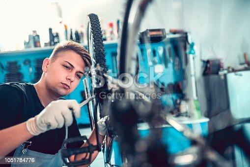 istock Learning Some New Bike Fixing Skills 1051784776