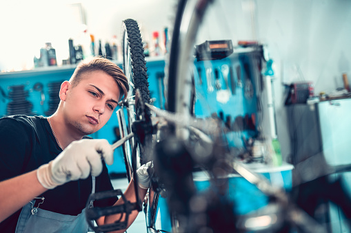istock Learning Some New Bike Fixing Skills 1051784776