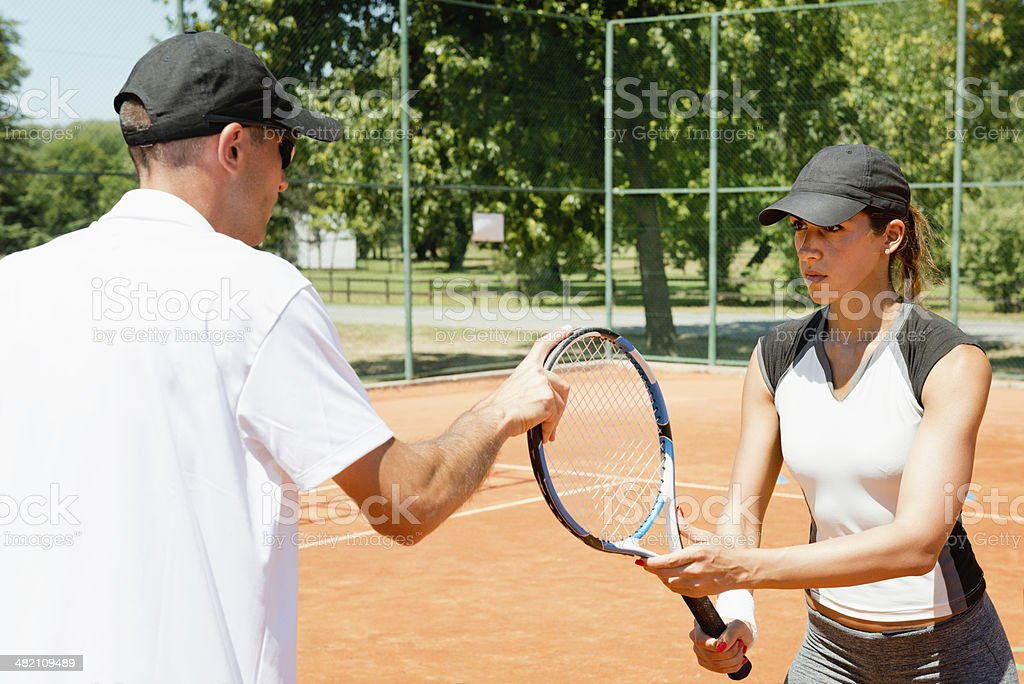 Learning tennis stock photo
