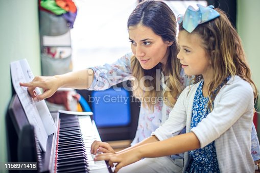 Learning the notes to all the keys. Child in music school.