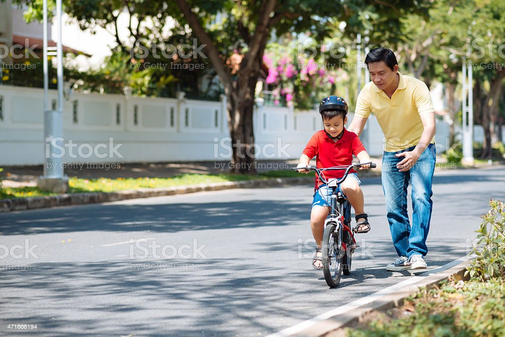 Learning to bike stock photo