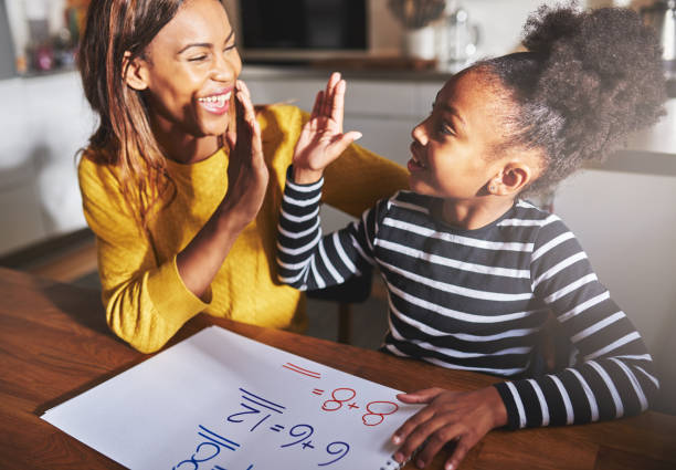 learning to calculate, high five success - homework stock photos and pictures