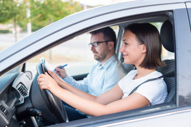 Learning to drive a car. Driving school Instructor and young female student, driving lesson driving instructor stock pictures, royalty-free photos & images