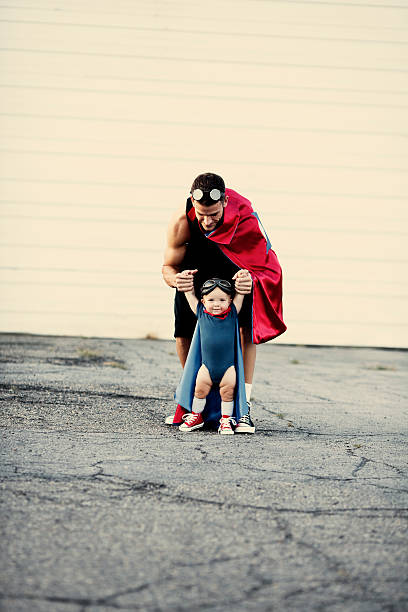 aprender a voar - baby super hero imagens e fotografias de stock
