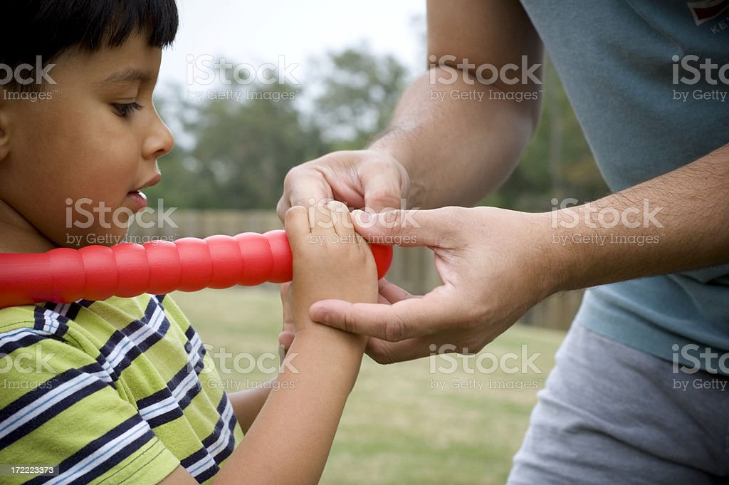 learning to grip a bat royalty-free stock photo