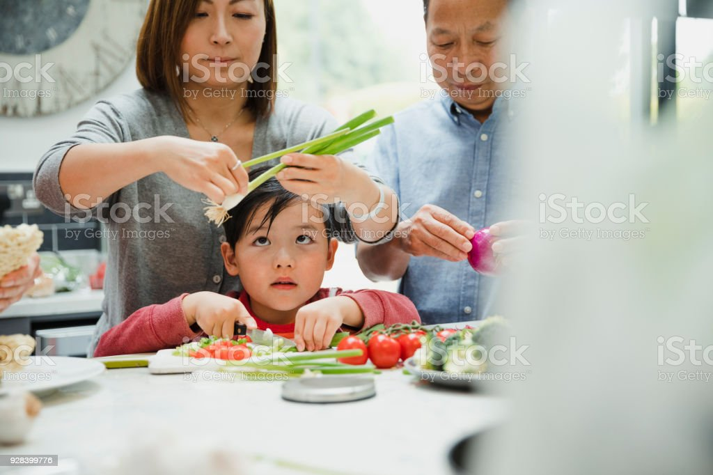 Learning to Make a Stir Fry with my Grandparents stock photo