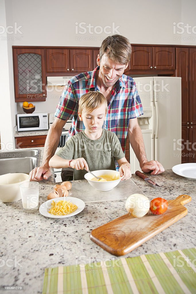 Learning to make an omelete royalty-free stock photo