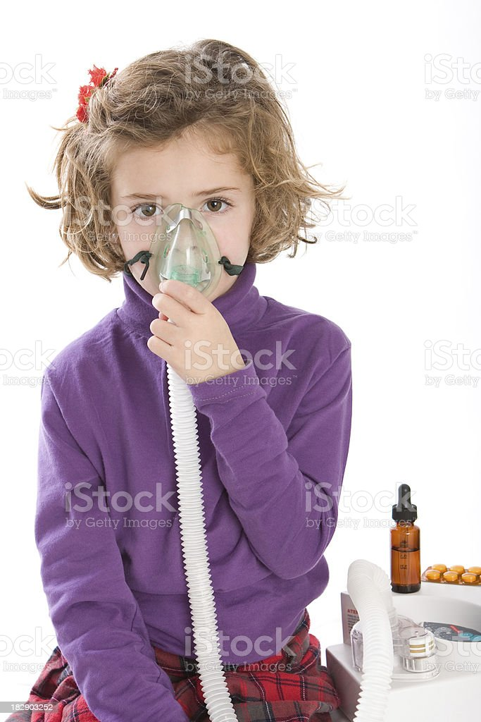 Learning to nebulized by her own stock photo