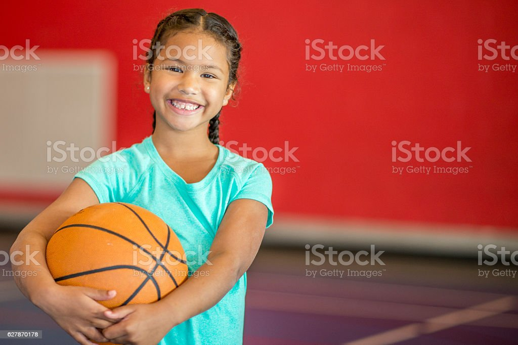 Learning to Play Basketball stock photo