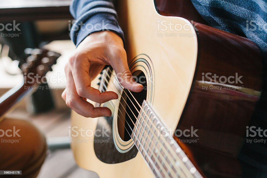 Learning to play the guitar. Music education and extra-curricular lessons. Lizenzfreies stock-foto