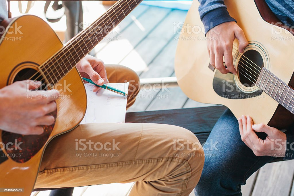 Learning to play the guitar. Music education and extra-curricular lessons. royalty-free stock photo