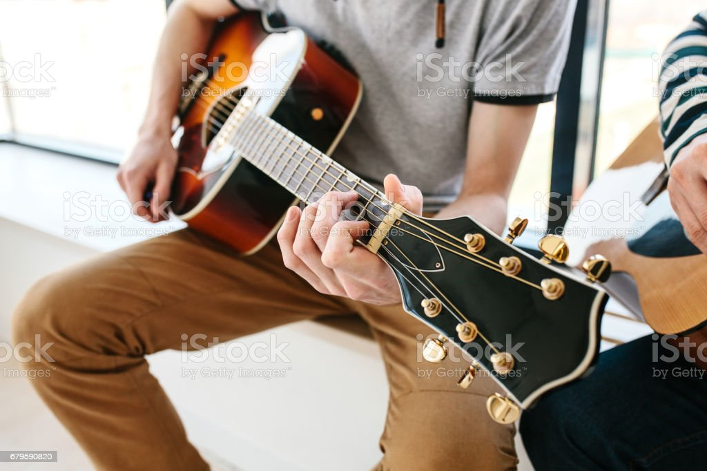 Learning to play the guitar. Music education and extra-curricular lessons. stock photo