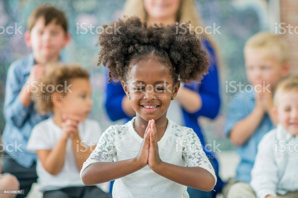 Learning to Pray stock photo