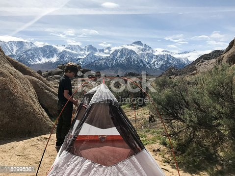 Child on a camping trip in the beautiful mountains of the Sierra Nevada Mountains of California
