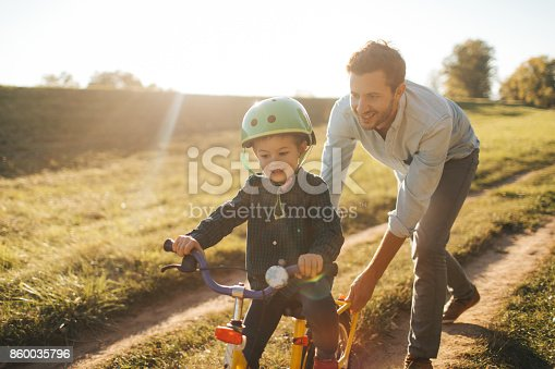 860036242 istock photo Learning to ride a bicycle 860035796