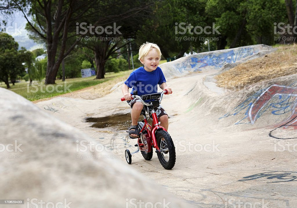 Learning to ride royalty-free stock photo